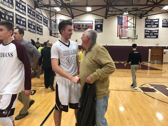 Southern Fulton's Dylan Gordon (30) is congratulated by the former Southern Fulton record holder Hob Barnhart (left) after breaking his record that stood for more than 50 years. Gordon scored 31 points on Monday against Northern Bedford to break the Southern Fulton all-time scoring record.