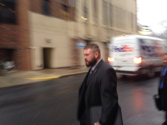 Tyson Baker leaves the federal courthouse in Harrisburg