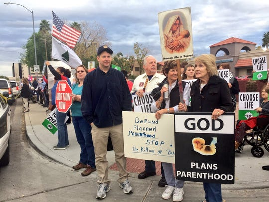 People opposed to abortions protest at the Planned