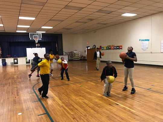 Students who attend an D.F. Huddle Elementary's afterschool program have recess time.