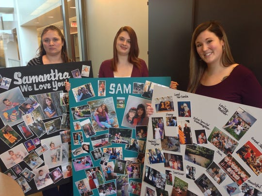 Family members of murder victim Samantha Young took three large collages of photos into court on Tuesday, Feb. 21, 2017, for the judge to see during the sentencing of Young's ex-boyfriend and killer, Marcus Bordelon. From left, they are Angelica Young, Sami's sister; cousin Kelsea Stein; and aunt Jordan Wasbers. (Liz Evans Scolforo photo)