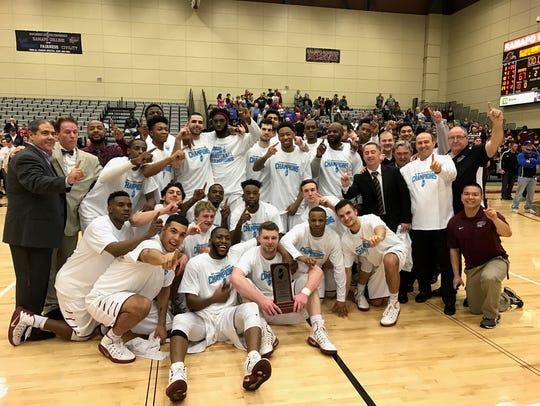 The Ramapo men's basketball team poses after its thrilling