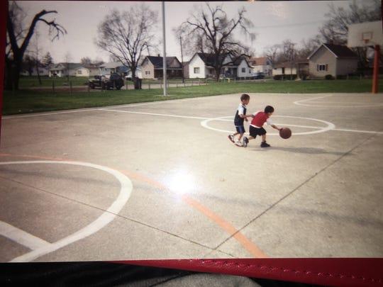 Matt and Mark Grimes play basketball as children. Matt