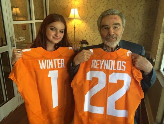"""The Last Movie Star"" stars Ariel Winter, left, and Burt Reynolds hold up custom-made UT jerseys."