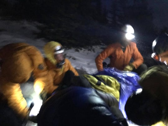 Rescuers work to bring Alan Arnette down off Twin Sisters.