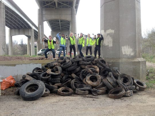 A group of volunteers from Virginia Tech worked with Asheville GreenWorks to pull 193 tires out of the French Broad River.