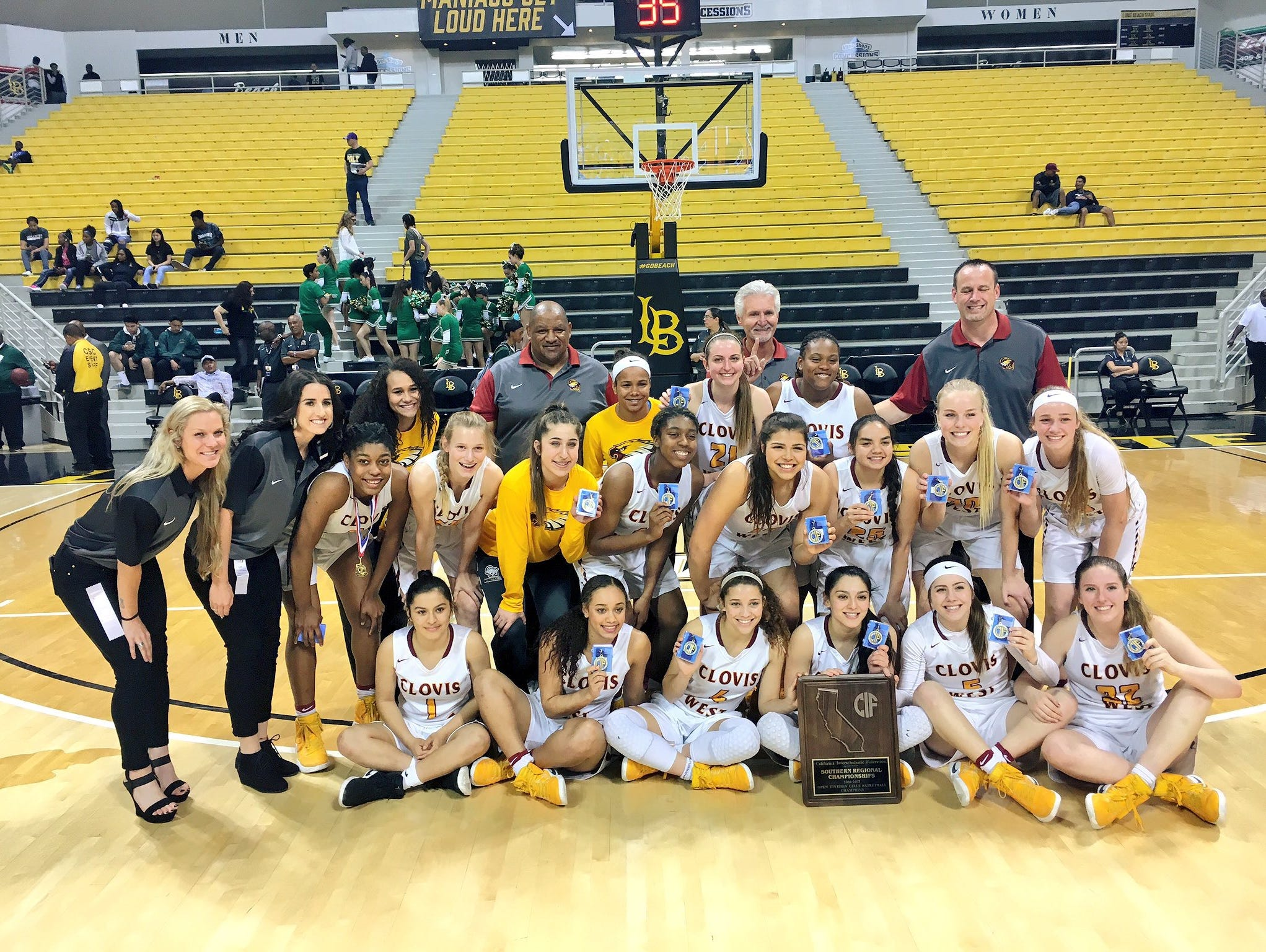 The Clovis West girls basketball team, coached by Craig Campbell, after winning the Southern California Regional last Saturday.