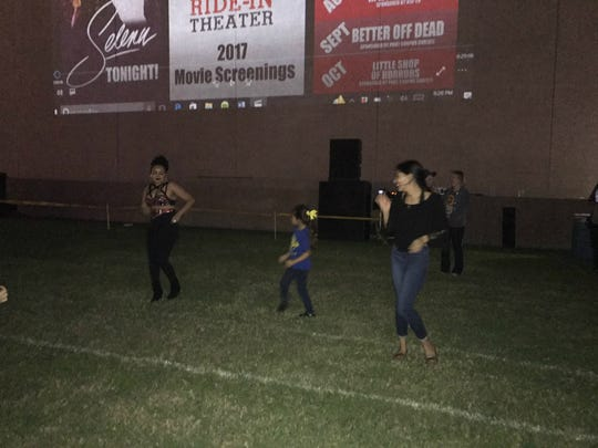 "Fans participate in a washing machine dance contest at a free screening of ""Selena"" on Friday, March 24, 2017, hosted by the Corpus Christi Ride-In Theater at the Water Gardens."