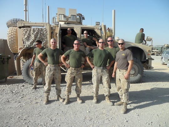 Some of the cowboys from hell strike a pose for Keaton Mahan, who is pictured on the far left. Tim May is to the right of Mahan, who is making a documentary of their experiences in Afghanistan.