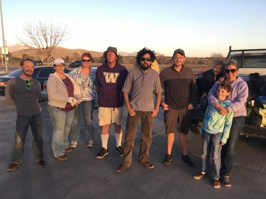 Volunteers pose after a day of picking up trash.