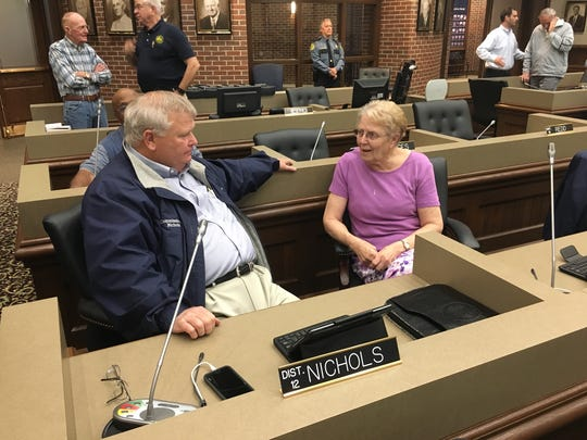 Commissioners Martha Brockman and Robert Nichols discuss