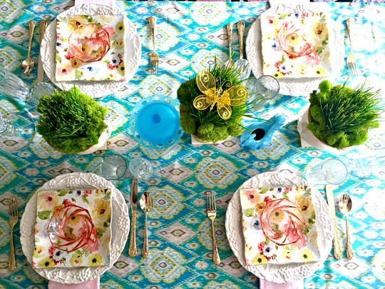 Go ahead and mix up patterns and colors when it comes to a fanciful table setting for spring.