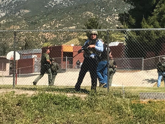Emergency personnel respond to a shooting inside North Park School Elementary School in San Bernardino, Calif.