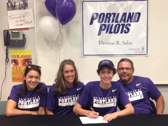 Thomas Salas was one of three Oñate runners to sign a college scholarship on Monday. Salas signed with the University of Portland.