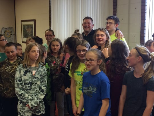 Dave Moseley enjoys a smile with his students after being named a Crystal Apple Award winner.