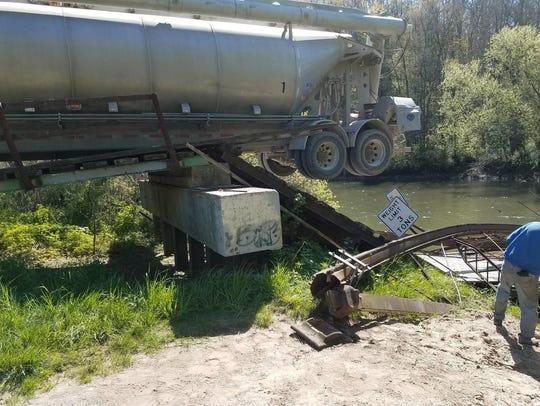 A truck trying to cross a rural bridge in Winneshiek
