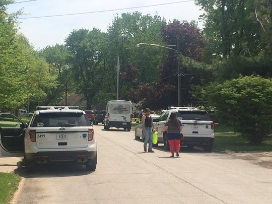 Police investigate a homicide Monday, May 8, 2017, at a home on Southwest 17th Street in Des Moines.
