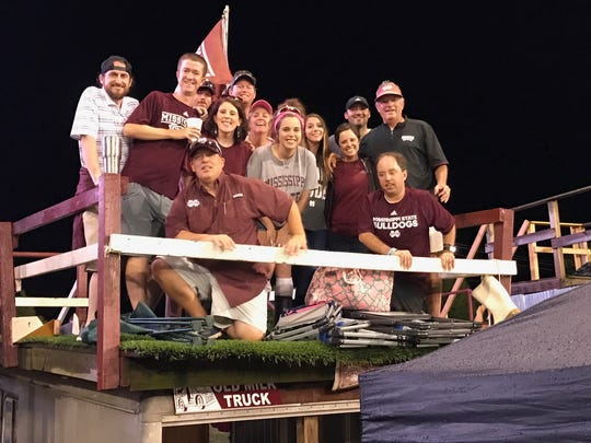 """The """"Old Milk Truck"""" crew atop the truck on Saturday night."""