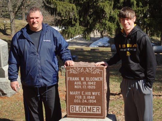Father and son Mike and Jace Bloomer, shown here in this photo from  2013, operate a small business, StoneDoctorz, in which they restore headstone. Over the past five years, the pair has done extensive volunteer and paid work for the Aspen Grove Cemetery in Burlington.