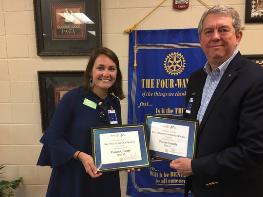 Rotary Club of Union County President Jessica Beaven proudly displays the awards with Senator Dorsey Ridley.