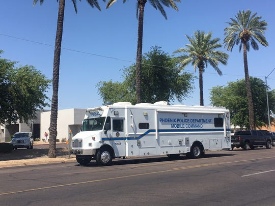 Phoenix police vehicle at the scene of the bank robbery