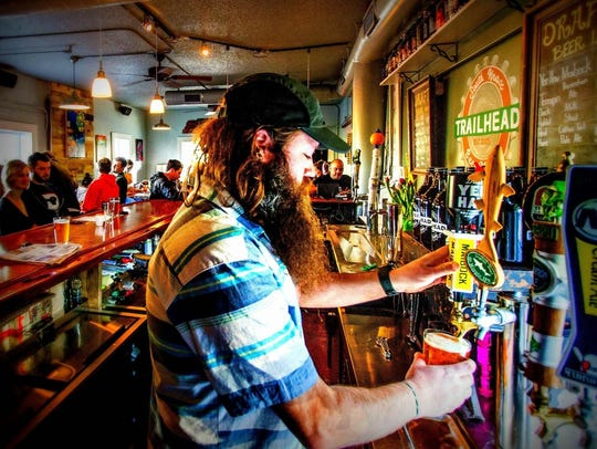 Joe Jennings stays busy while serving craft beers to