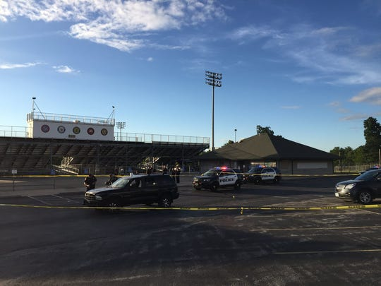 Emergency vehicles at the scene of the shooting Thursday in the parking lot of JFK Stadium.