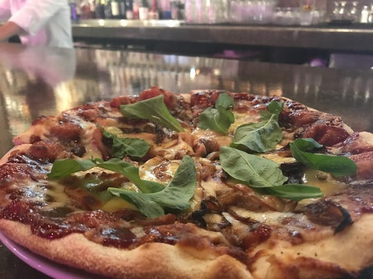 The smoked pork pizza at The Pitch features meat that's