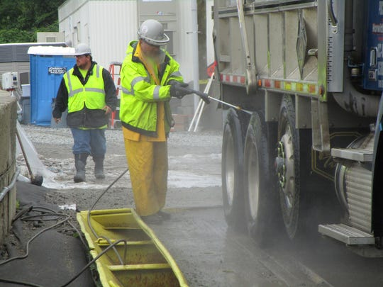 After being loaded with contaminated sediment, each dump truck  at the Pompton Lakes site is washed down before it leaves for a Pennsylvania landfill so no contaminated sediment gets tracked through local streets.