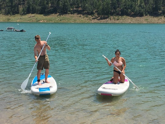 Two Wilderness campers try out paddle boarding on Grindstone