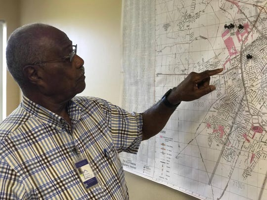 Joe Page, executive director of the Alexandria Housing Authority, points to a map of affordable housing units in the city. The United Way's ALICE Report underscores the need for more affordable housing locally.