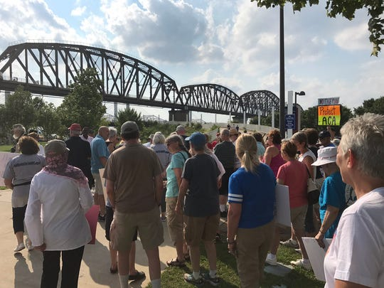 Members of Indivisible Kentucky prepare to begin the walk Friday.