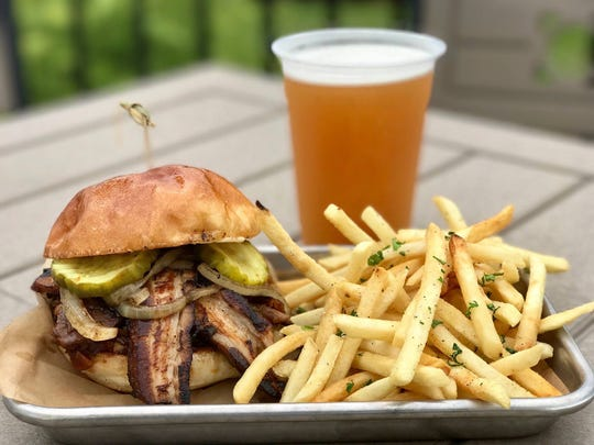 """Cleats Bar & Grille's Trio """"McRib"""" Sandwich features house smoked spareribs, cured pork belly, bacon honey, smoked pepper aioli, caramelized onions, pickles and house BBQ sauce."""