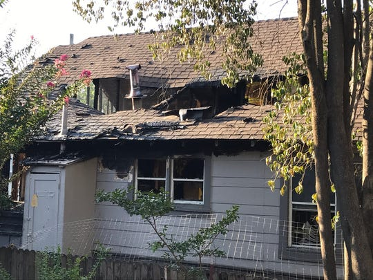 A fire started at a home on Magnolia Avenue due to an improperly discarded cigarette, according to firefighters.