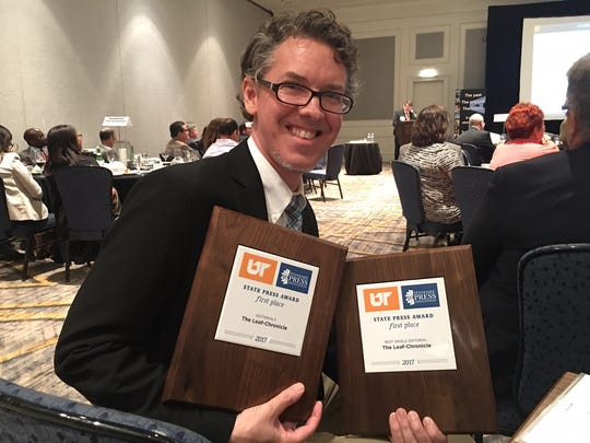 Chris Smith with his awards for Best Editorials and
