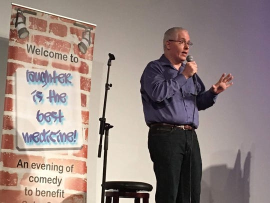 News-Press reporter Charles Runnells performs stand-up