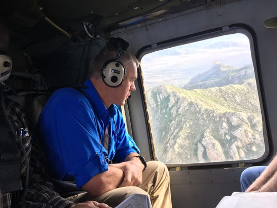 U.S. Secretary of the Interior Ryan Zinke looks out
