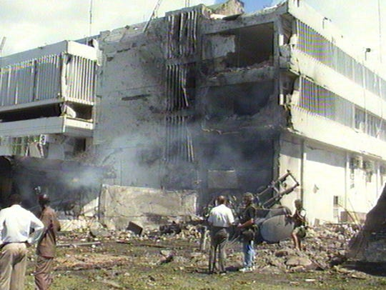 Smoke rises from the U.S. Embassy in Dar es Salaam,