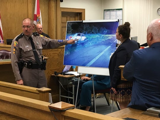 Florida Highway Patrol investigator Sgt. William Pascoe points to a crash scene photo of the car driven by Jennifer Jenkins as Assistant State Attorney Hannah Potter and Judge Marcus Ezelle look on Wednesday, Aug. 23, 2017, in Hardee County.