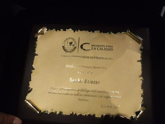 The Instituto La Calidad Honory Membership plaque.