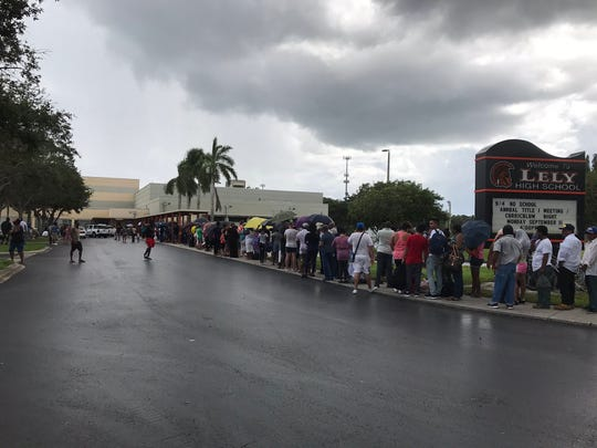 Hundreds wait outside Lely High School on Friday, hoping to get a spot inside the evacuation shelter before Hurricane Irma arrives.