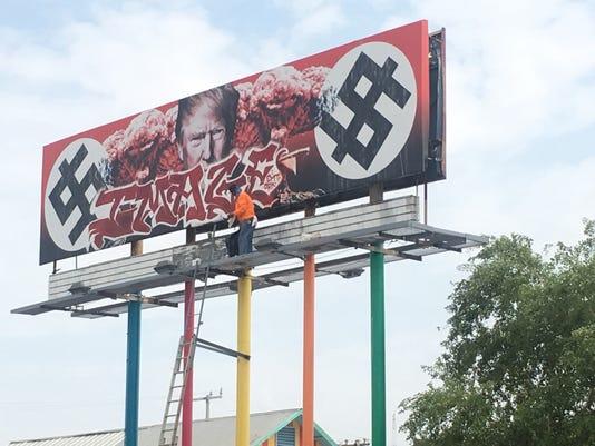636404858202051621-Trump-billboard-vandalism2.JPG
