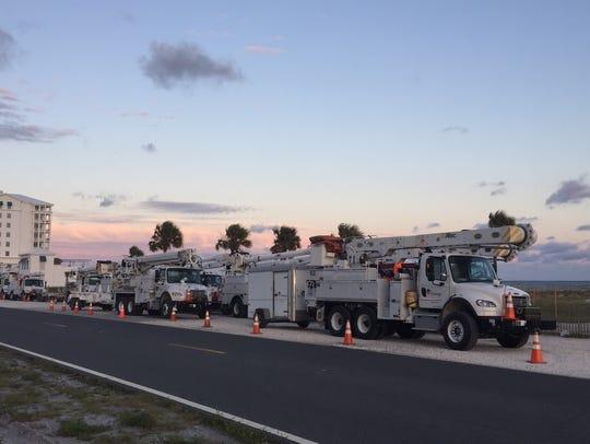 Gulf Power trucks lined along Pensacola Beach.