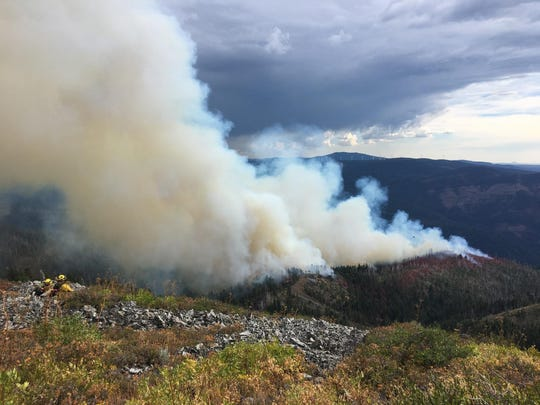 Firefighters hiked to a fire southeast of Big Bend in Shasta County on Tuesday afternoon.