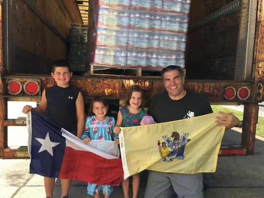 Restaurateur Joe Leone Introna with his children before departing earlier this month for Texas with four tractor trailers full of bottled water for Hurricane Harvey victims.