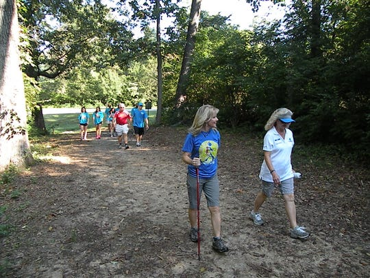 Missy Kane leads a group of hikers Saturday at Victor