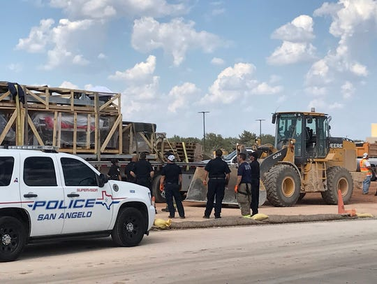 Officers with the San Angelo Police Department investigate