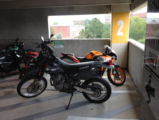 Motorcycles fill a designated space in one of FSU's
