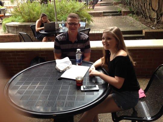 Caroline Elmore, far right, and her boyfriend Ryan Bruseski, talk parking on their lunch break.
