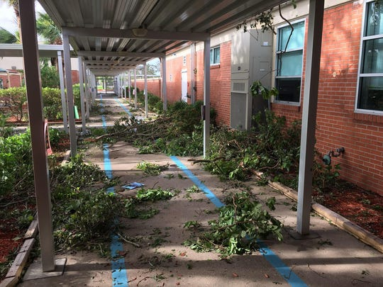 Tree limbs and other brush line the walkways of Franklin Park Elementary School after Hurricane Irma. Staff came out to clean up Franklin Park Elementary School's campus after Hurricane Irma. Staff came out to clean up Franklin Park Elementary School's campus after Hurricane Irma.